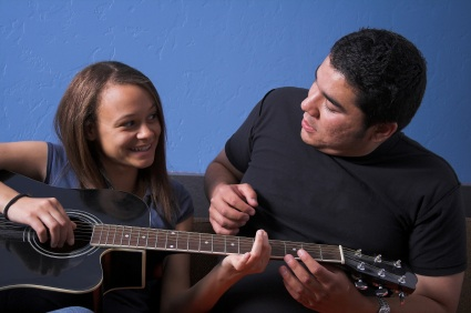 13115_guitar-teacher-and-young-girl.jpg